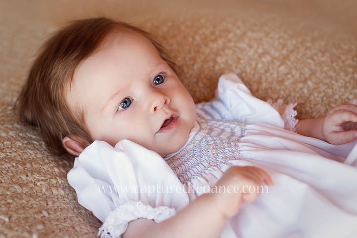 A natural light portrait of a 3 month old baby girl.