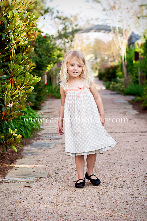 Mikayla stands in an alley in The Woodlands.