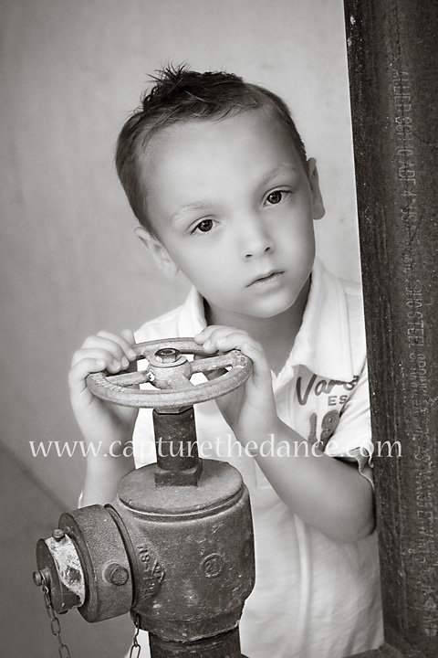 A boy holds a water meter in The Woodlands.