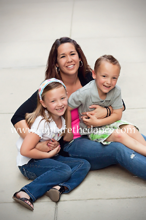 Smith Family poses on the sidewalk in Market Street in The Woodlands.